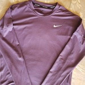 Women's Nike Dri-fit long sleeve running top.